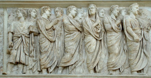 This sculpture engraved into the Ara Pacis shows a procession of priests. When a Roman was acting as a priest he would pull the folds of the toga over his head.